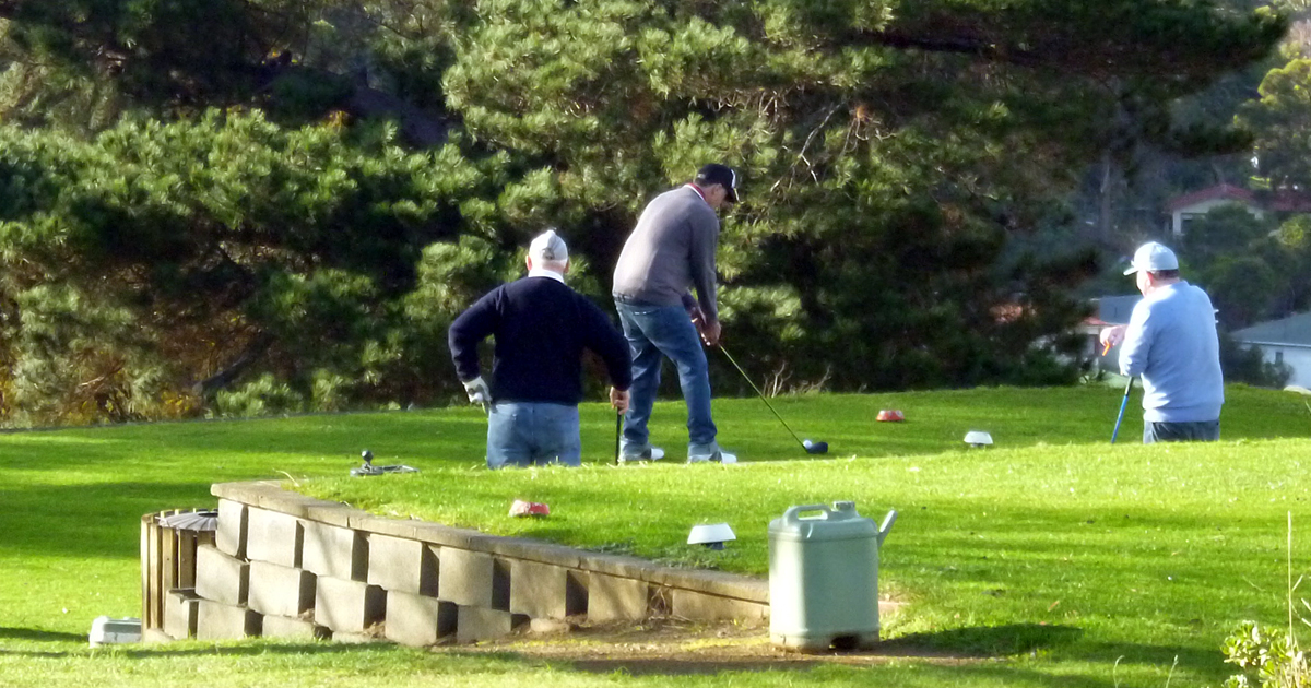 Men playing golf at New Norfolk