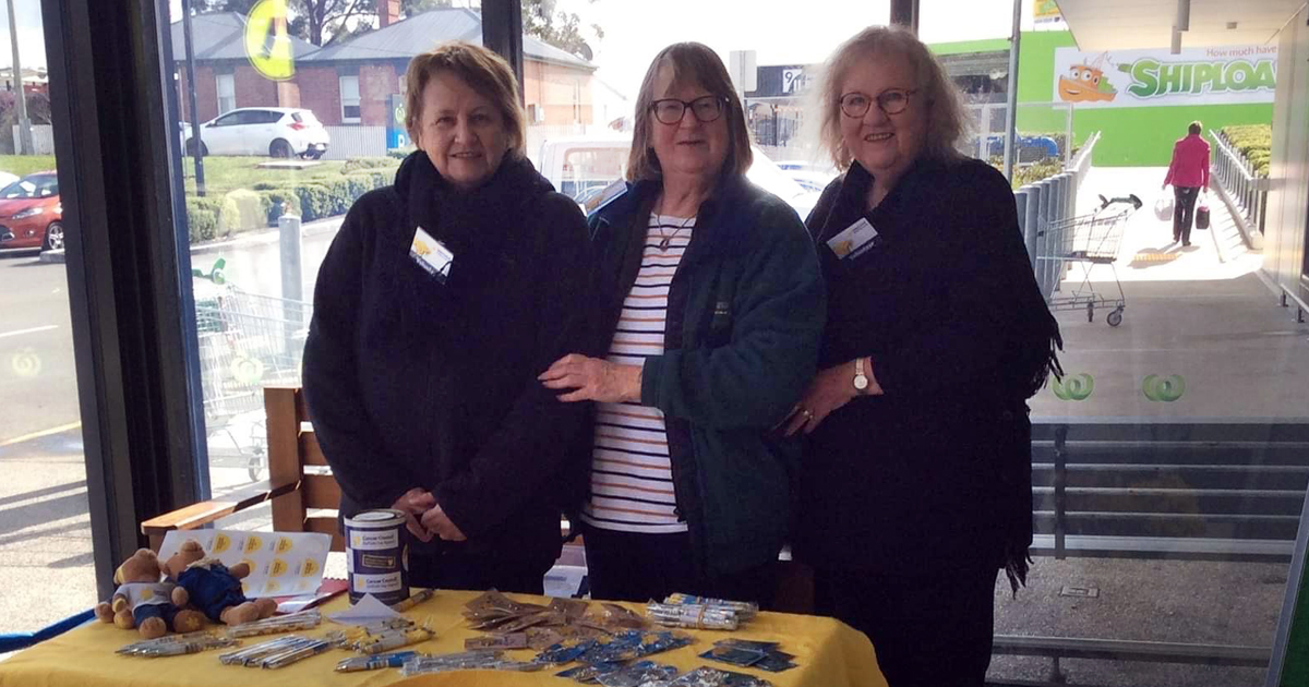 Women operating Daffodil Day stall at New Norfolk
