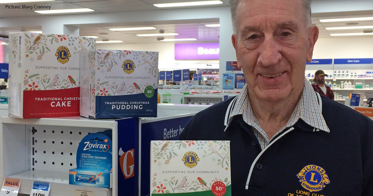 Barry McDougall with Lions Club Christmas cakes