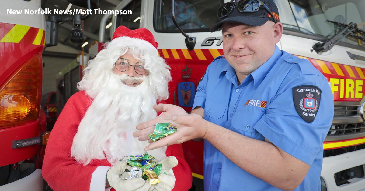 Santa Claus with a fireman