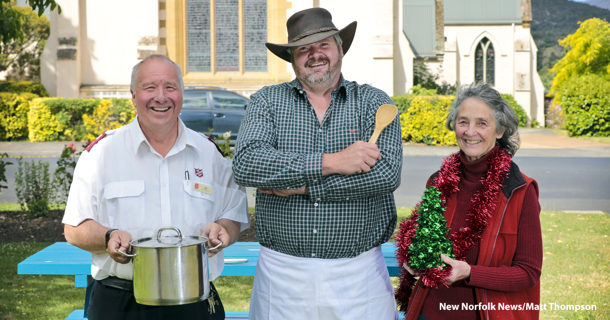 Three people promoting Christmas Day lunch
