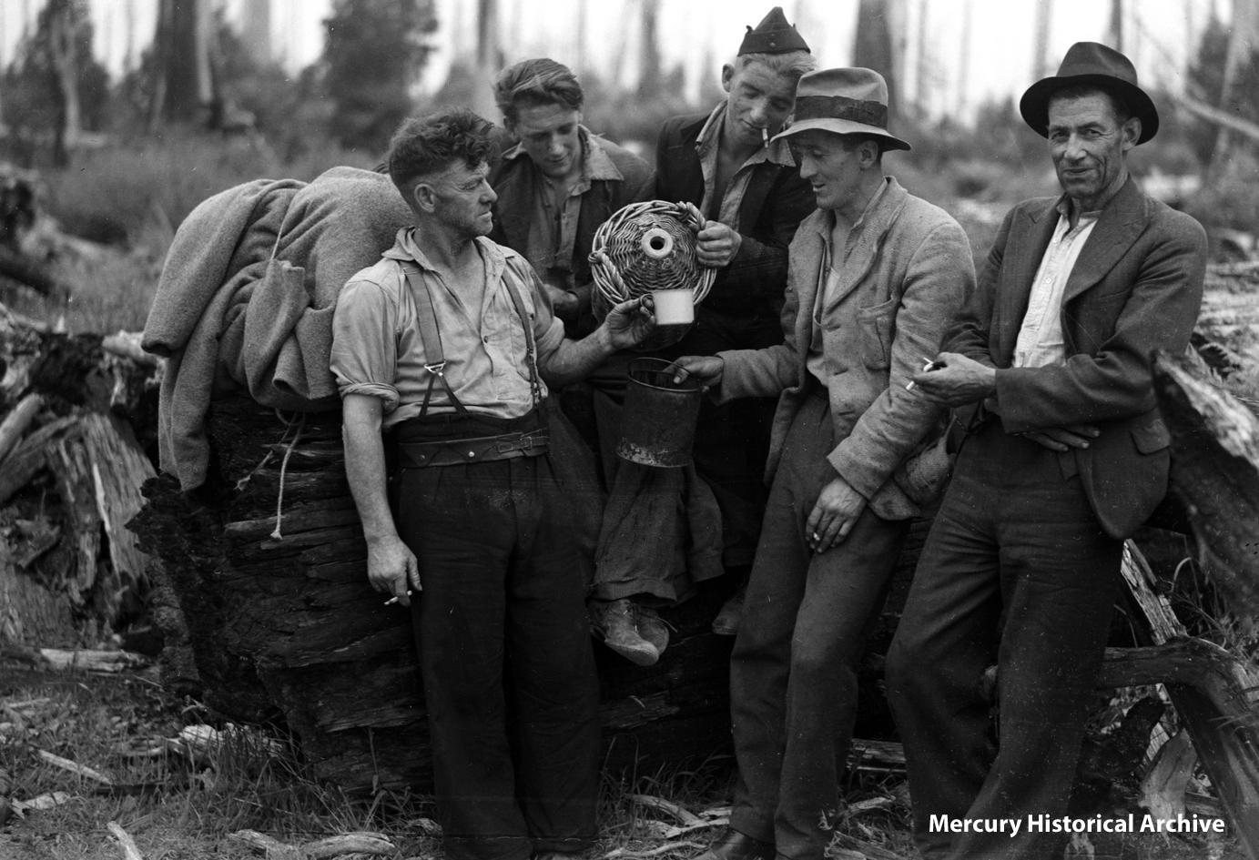 men having a drink of water after a bushfire