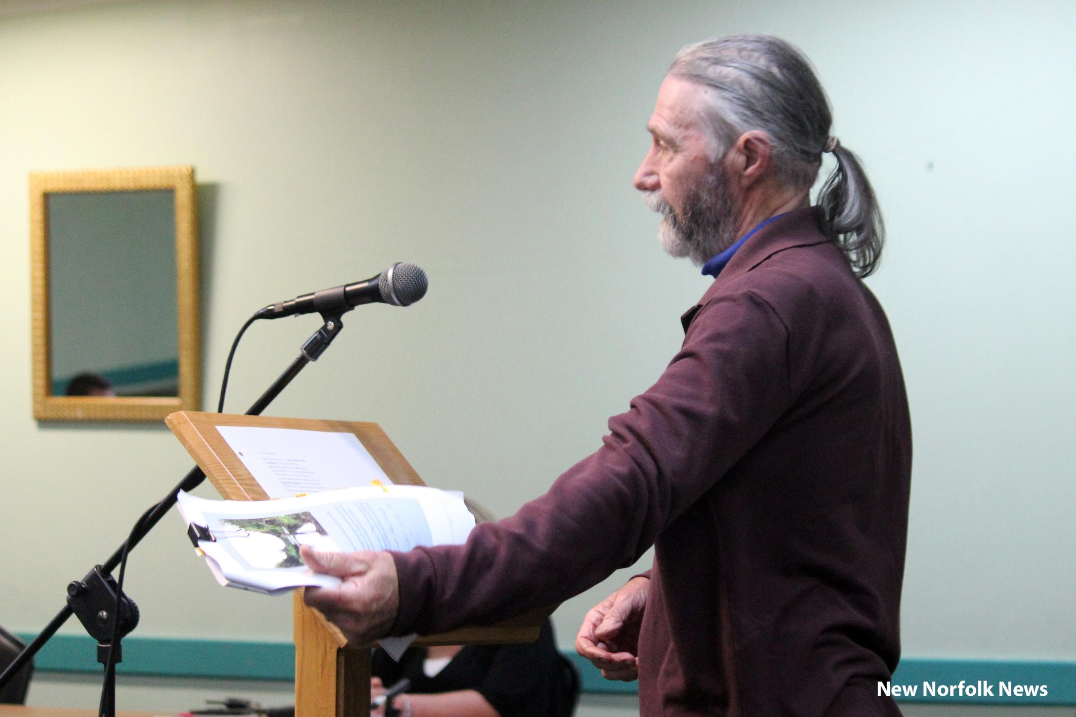 man speaking at a meeting
