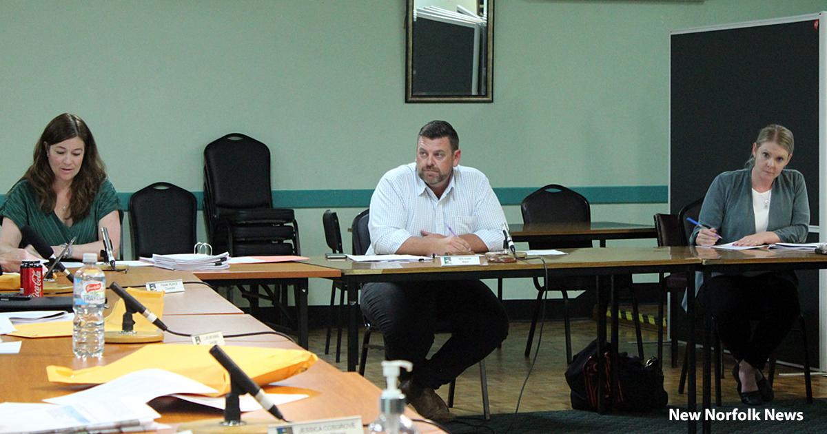 three people at a meeting