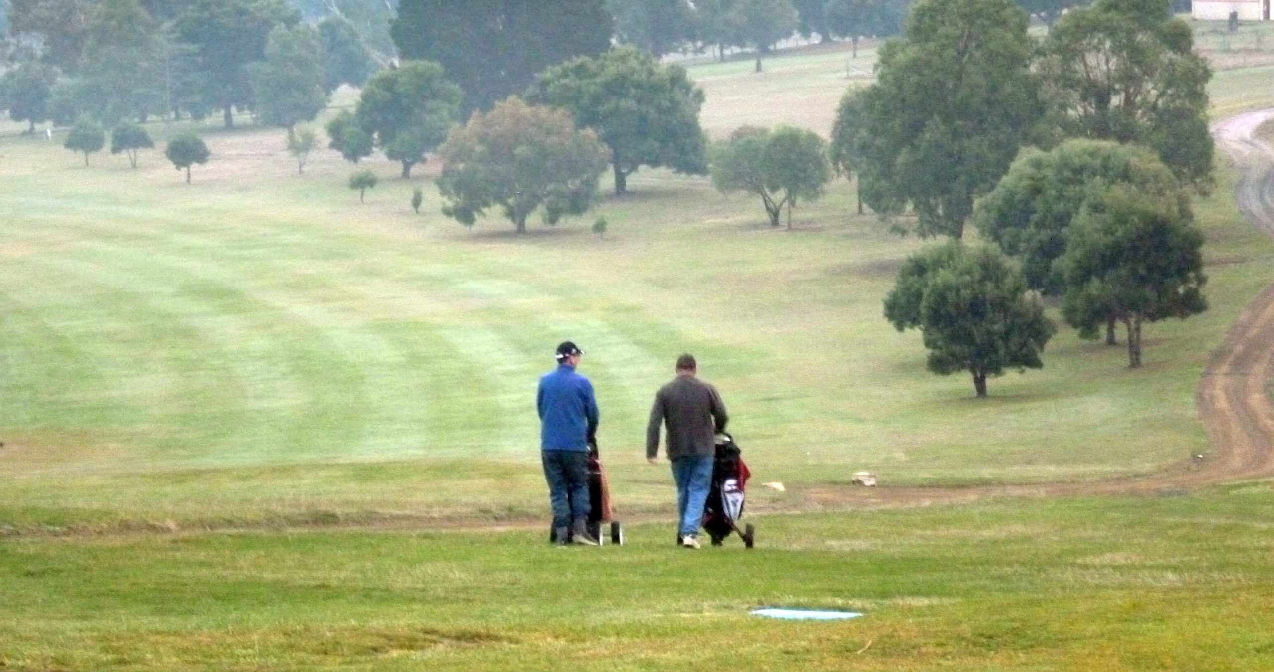 two men on a golf course